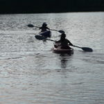 Image of kayakers on pond